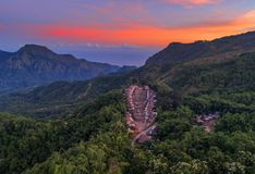 Aerial view of high thatch-roofed houses of traditional Bena village, Flores, Indonesia