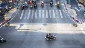 A aerial view of  the high traffic on a street intersection with. A aerial view of  the high traffic on a street intersection with crosswalk and people and Royalty Free Stock Photography