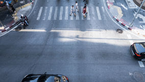 A aerial view of  the high traffic on a street intersection with people. A aerial view of  the high traffic on a street intersection with crosswalk Stock Photos