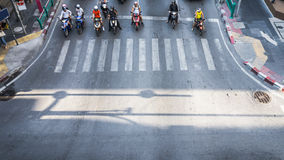 A aerial view of  the high traffic on a street intersection with people and motorcycle. A aerial view of  the high traffic on a street intersection with Royalty Free Stock Image