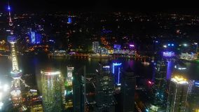 Aerial view of highrise buildings with river at night,Oriental Pearl Tower. stock video