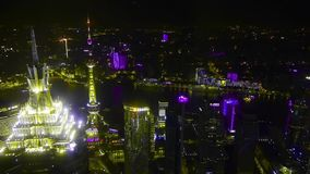 Aerial view of highrise buildings with river at night,Oriental Pearl Tower. stock video footage