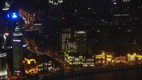 Aerial view of highrise buildings with river at night,shipping & urban traffic. stock video