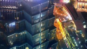 Aerial view of highrise buildings & urban traffic at night,time lapse. Elevated view of high-rise buildings rooftop crown at night in Shanghai,China.busy stock video
