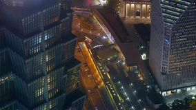 Aerial view of highrise buildings & urban traffic at night,time lapse. stock footage