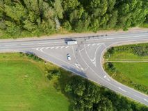 Aerial view of highway with car. Aerial view of a country road with moving car. Car passing by. Aerial road. Aerial view flying. Captured from above with a Royalty Free Stock Photo