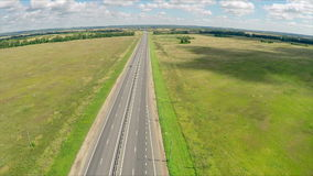 Aerial view of a highway with cars driving along a road. The gas station, hotel and road service. stock video footage