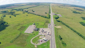Aerial view of a highway with cars driving along a road. The gas station, hotel and road service. stock video