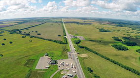 Aerial view of a highway with cars driving along a road. The gas station, hotel and road service. stock footage
