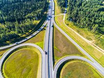 Aerial view of highway in city. Cars crossing interchange overpass. Highway interchange with traffic. Aerial bird`s eye photo of royalty free stock images