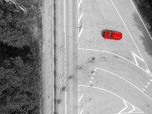 Aerial view of highway. Aerial view of a country road with moving red car. Car passing by. Aerial road. Aerial view flying. Captur. Ed from above with a drone stock image