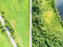 Aerial view of highway. Aerial view of a country road near the lake. Car passing by. Aerial road. Aerial view flying. Captured fro. M above with a drone. Soft royalty free stock images