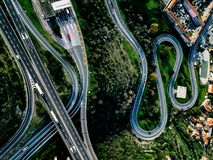 Aerial view of highway, expressway and motorway with a toll payment point in Italy. Aerial view of highway, expressway and motorway with a toll payment point in stock image
