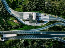 Aerial view of highway, expressway and motorway with a toll payment point in Italy. Aerial view of highway, expressway and motorway with a toll payment point in royalty free stock photography