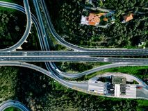 Aerial view of highway, expressway and motorway with a toll payment point in Italy. Aerial view of highway, expressway and motorway with a toll payment point in royalty free stock photo