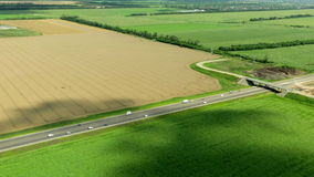Aerial view of highway and field. Aerial view of highway in HD stock footage
