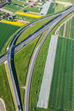 Aerial view of highway and green harvest fields Royalty Free Stock Photo