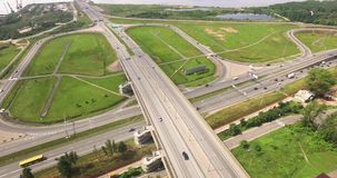 Aerial view of highway interchange of modern urban city. stock video