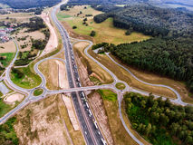 Aerial view of highway junction, green forest, Netherlands. Aerial view of highway junction in the middle of green forest, traffic jam, Netherlands Royalty Free Stock Photo