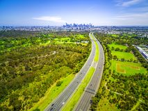 Aerial view of highway and Melbourne City skyline. Aerial view of highway and Melbourne City skyline Stock Photos