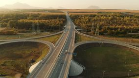 Aerial view. Highway and overpass with cars and trucks. The road junction is a two-tier road junction outside the city stock video