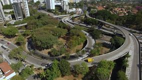 Aerial view of highway and overpass in city. Top view city traffic of highway and bridge, logistics. Sao Paulo city, Brazil. South America stock footage