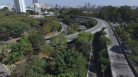 Aerial view of highway and overpass in city. Top view city traffic of highway and bridge, logistics. Sao Paulo city, Brazil. South America stock video footage