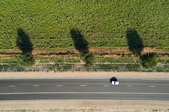 Aerial view of a highway passing through green fields Royalty Free Stock Photos