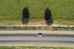 Aerial view of a highway passing through green fields Stock Image