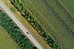 Aerial view of a highway passing through green fields Royalty Free Stock Images