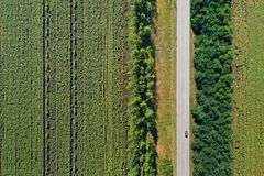Aerial view of a highway passing through green fields Royalty Free Stock Image