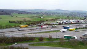 Aerial view of highway and rest area stock footage