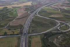 Aerial view of a highway. Aerial view of a right-hand turn of a highway in italy Stock Image