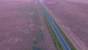 Aerial view highway road on dusk semi-trailer. Aerial scene of outback highway or open road on dusk sunset with truck lorry Semi-trailer traveling on rural stock footage
