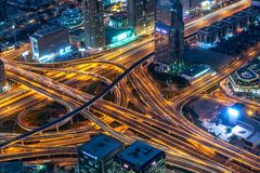 Aerial view of a highway road interchange in Dubai at night, UAE royalty free stock images