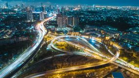 Aerial view highway road intersection at dusk for transportation, distribution or traffic background royalty free stock photo