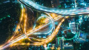 Aerial view highway road intersection at dusk for transportation, distribution or traffic background royalty free stock photos