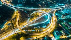 Aerial view highway road intersection at dusk for transportation, distribution or traffic background royalty free stock image