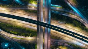 Aerial view highway road intersection at dusk for transportation, distribution or traffic background royalty free stock images
