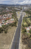 Aerial view of highway and town Royalty Free Stock Photography