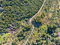 Aerial view of hiking sandy trails in dry green mountain stock photo