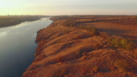 Aerial view of hills on the riverside at sunset.  stock footage