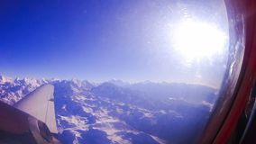 Aerial view of Himalayas from airplane window on clear day. Aerial view of Himalayas from airplane window on sunny day Royalty Free Stock Photography