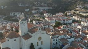 Drone view of ancient church in sunlight, Cadaques. Aerial view of historic building of St. Mary`s church in Cadaques illuminated with sunlight. Drone shot of stock video footage