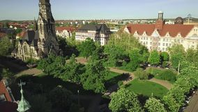 Aerial view of historic buildings in Leipzig including the Michaeliskirche Zentrum-Nord church, Germany. Aerial view of historic buildings in Leipzig, Germany stock video footage