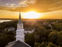 Aerial view of historic church steeple and sunset in Beaufort, S stock photos