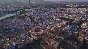 Aerial view of historic city and cathedral of Seville, Spain. Aerial view of historic city, bullfight areana and cathedral of Seville, Andalusia, Spain stock video