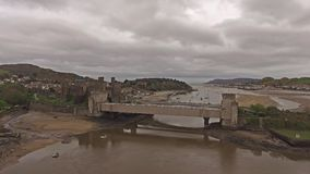 Aerial view of the historic town of Conwy with it`s medieval castle - Wales - United Kingdom.  stock video footage