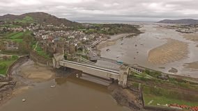Aerial view of the historic town of Conwy with it`s medieval castle - Wales - United Kingdom.  stock video