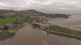 Aerial view of the historic town of Conwy with it`s medieval castle - Wales - United Kingdom.  stock footage